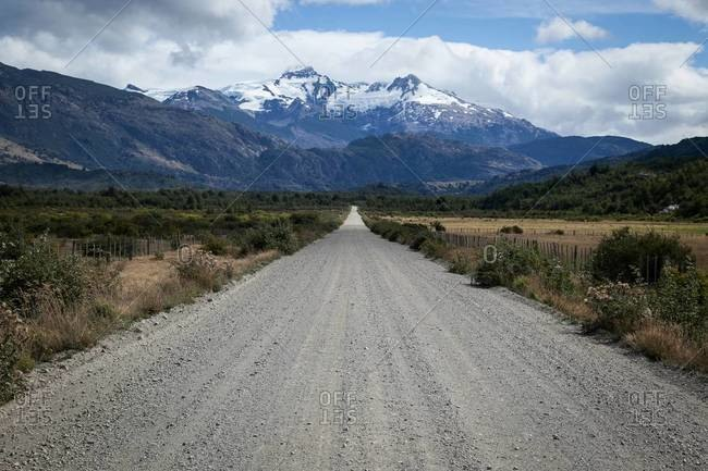 An empty country road in the mountains of Patagonia, Chile