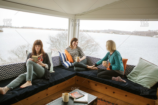 Three woman relaxing at weekend cottage by the lake