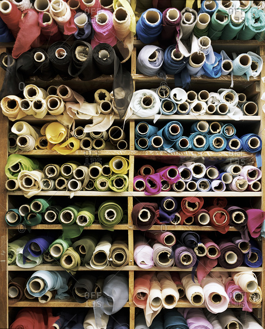Bolts of fabric on shelves