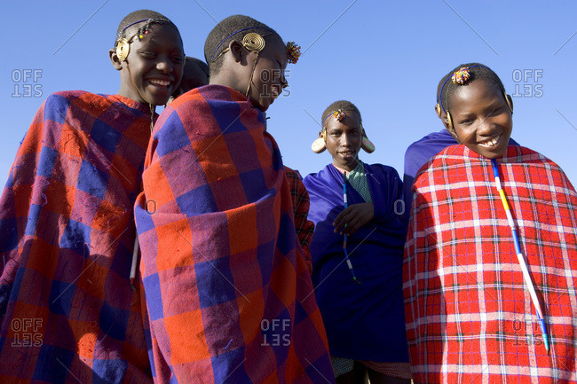 Maasai, near Samburu, Kenya - January 13, 2006: Young Maasai boys wrapped in blankets, Maasai Mara, Kenya
