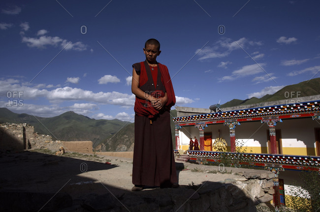 Kyushu, Qinghai Province, China - July 23, 2006: Student Buddhist monk at the Dondrub Ling Monastery in Kyushu, Qinghai Province, China