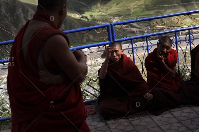 Kyushu, Qinghai Province, China - July 22, 2006: Student Buddhist monks debating at the Dondrub Ling Monastery in Kyushu, Qinghai Province, China