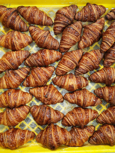 Top view of fresh croissants in a crate