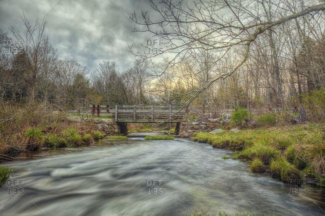 Wooden bridge across a river
