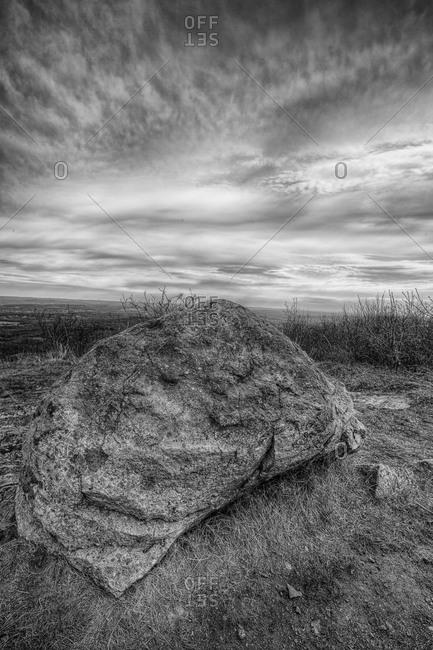 A rock under an overcast sky