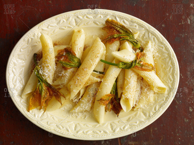 Penne with zucchini flowers and parmesan