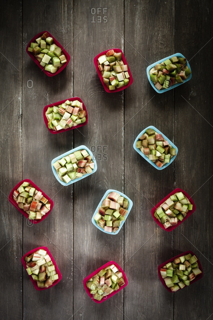 Baking pans filled with buckwheat batter garnished with rhubarb