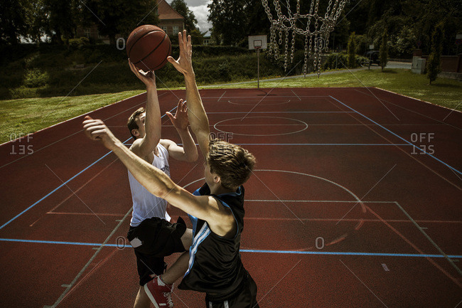 Two young basketball players at duel
