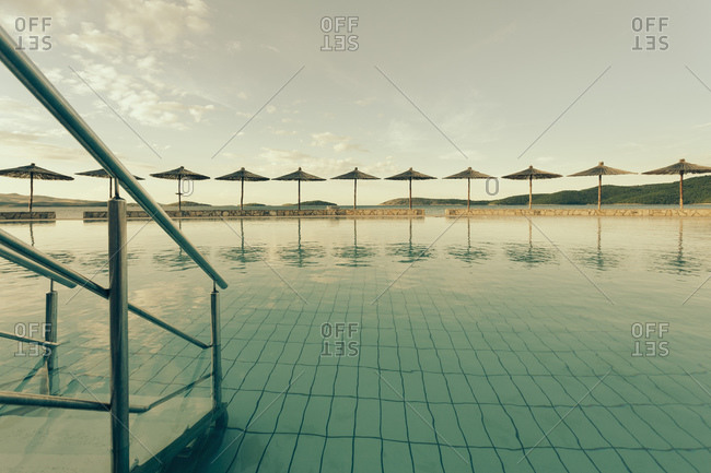 Sunshades, Swimming pool of a hotel facility, Evening mood