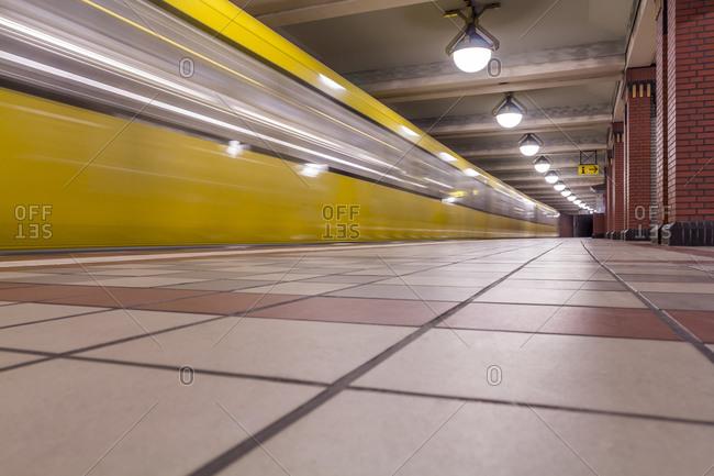 Subway station Rathaus Reinickendorf with moving underground train, Berlin, Germany