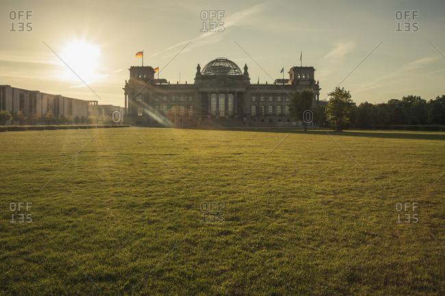 Reichstag building against the sun in the morning, Berlin-Tiergarten, Berlin, Germany
