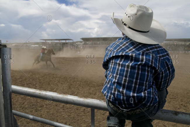 Child sitting on local rodeo in Galisteo, New Mexico, United States