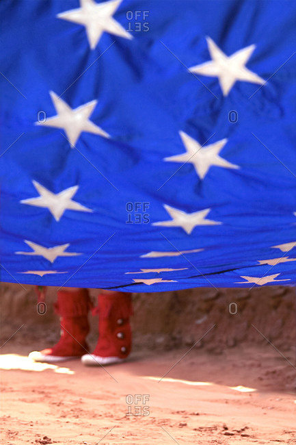 Red boots under the flag of USA in Gallup, New Mexico, United States