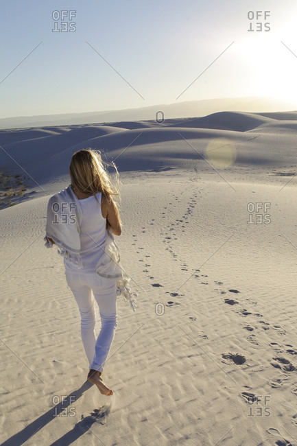 Woman walking in White Sands National Park, New Mexico, USA