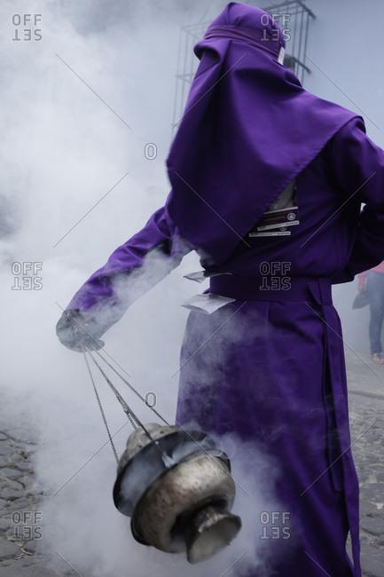 Person swinging an incense at the Semana Santa celebration in Antigua, Guatemala