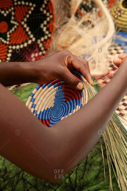 African women demonstrating basket weaving at a folk art market in Santa Fe, New Mexico
