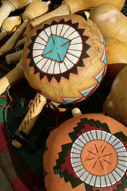 Close up of Native American hand painted rattles made from gourds