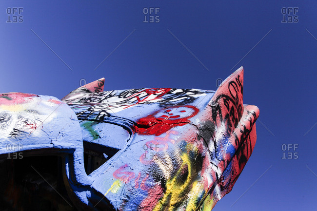New Mexico - April 27, 2012: Close up of a painted car in the Cadillac Ranch along Route 66