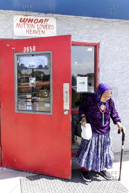 Shiprock, New Mexico - May 12, 2012: Navajo woman exiting a store in Shiprock, New Mexico