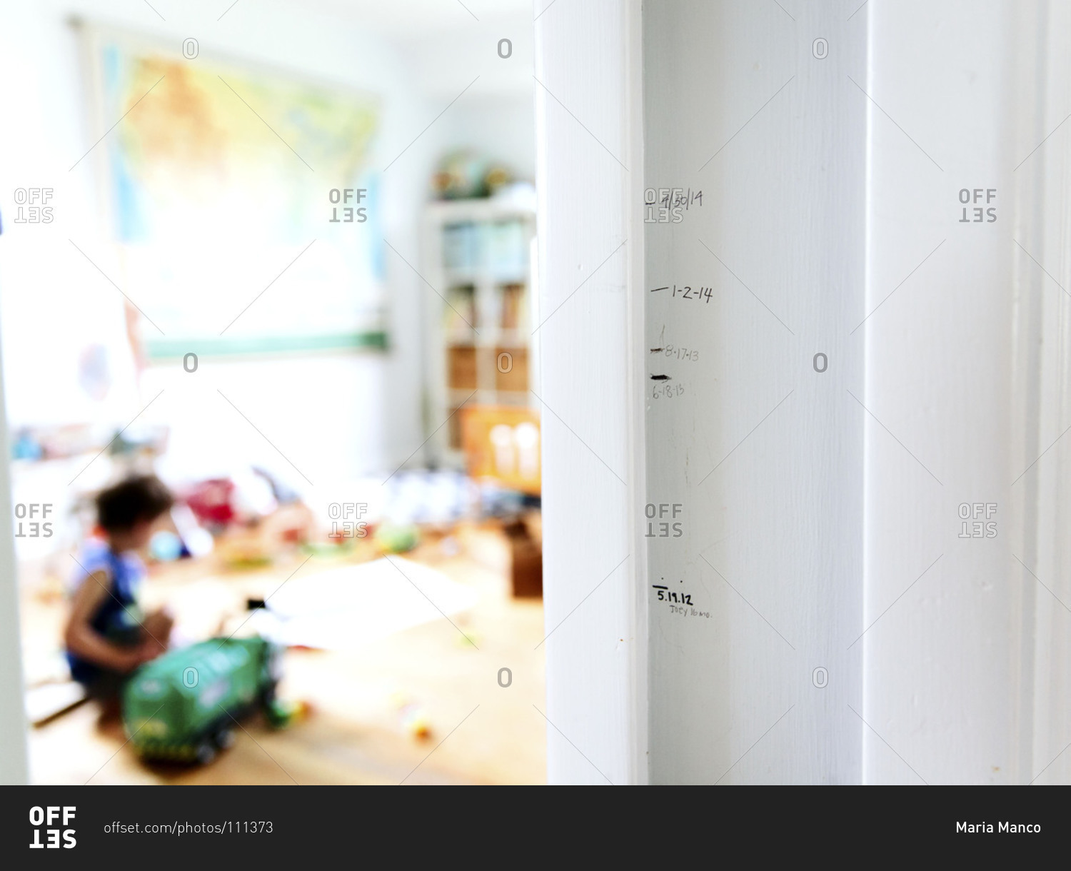 Height markings on a door frame stock photo - OFFSET