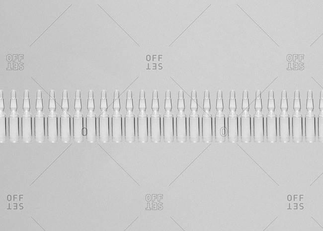 Ampoules in a row on white background