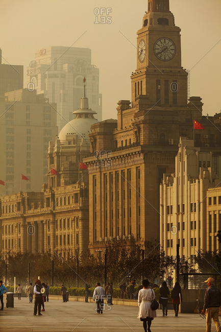 Buildings on the Bund, along the banks of the Huangpu River, showing Custom House (right) and the former Hong Kong and Shanghai Bank Building, Shanghai, China.