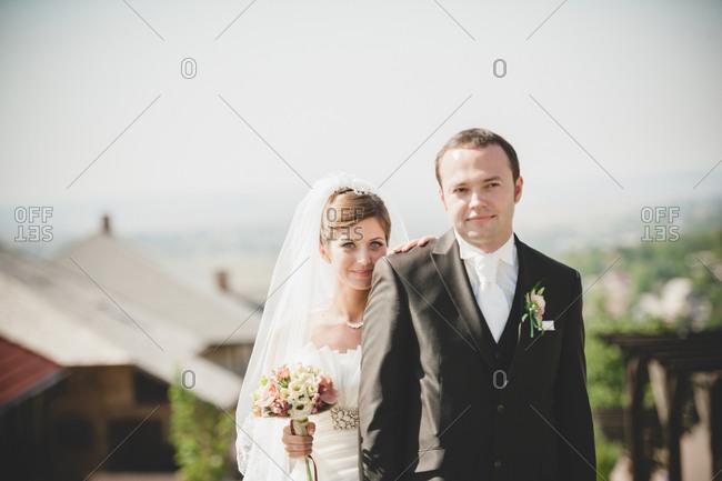 Newlywed couple posing outdoors