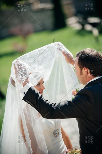 Groom unveiling his bride