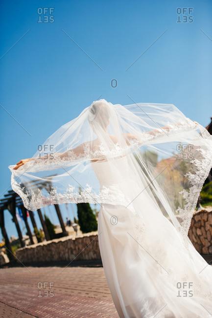 Bride enjoying the wind in her wedding dress
