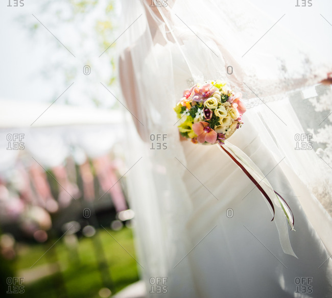 Bride covered with veil holding a bouquet