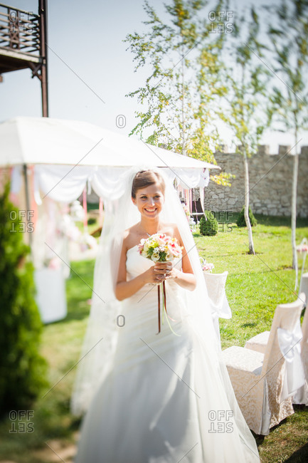Bride holding a wedding bouquet at a wedding venue
