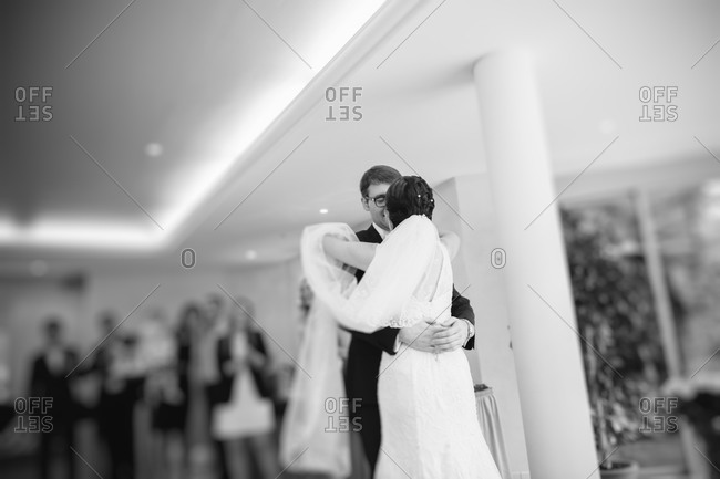 Newlyweds dancing at a wedding reception
