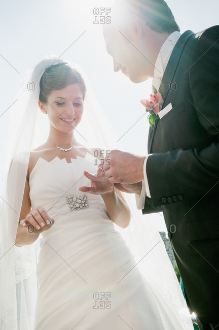 Couple exchanging rings at their wedding ceremony
