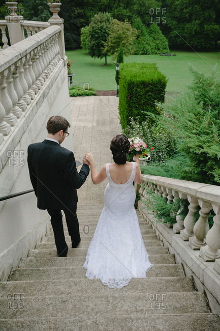 Newlywed couple walking down stairs
