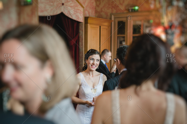 Bride chatting with a at guest the reception