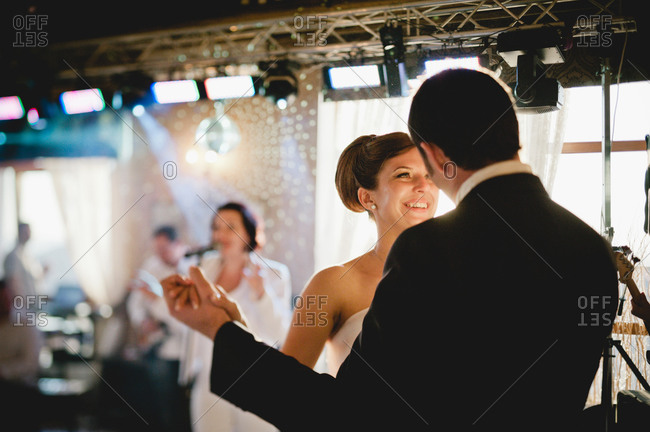 Newly married couple dancing at reception