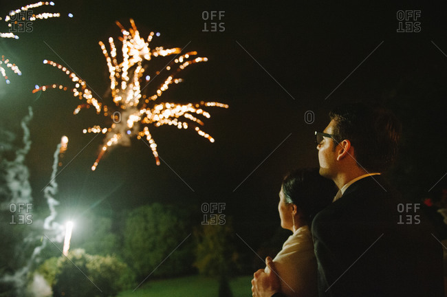 Newlyweds staring fireworks show