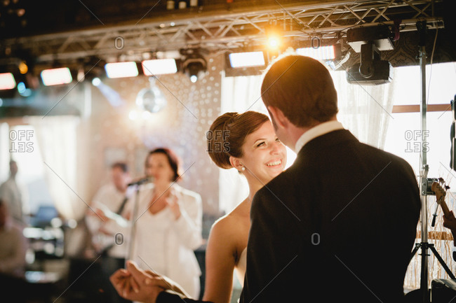 Newlywed dancing to live band at the reception