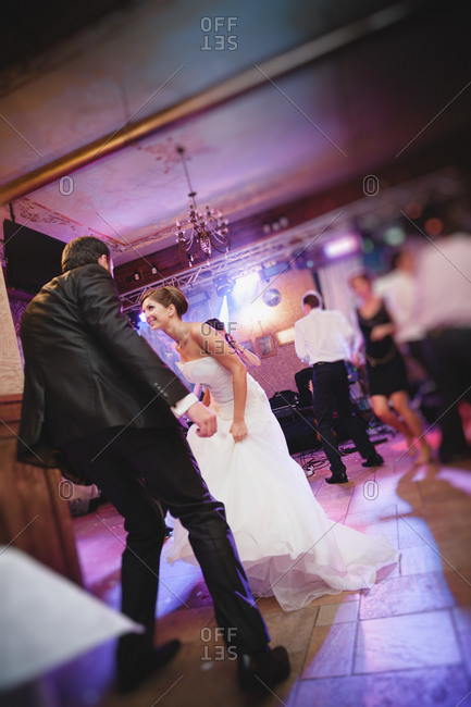 Newlywed couple busting a move at the reception