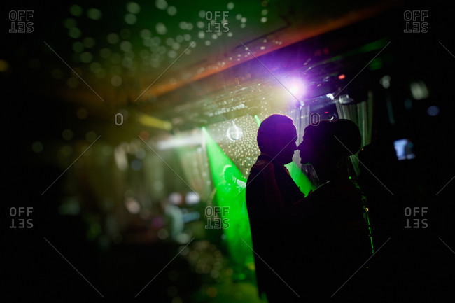 Silhouette of newlywed at wedding reception