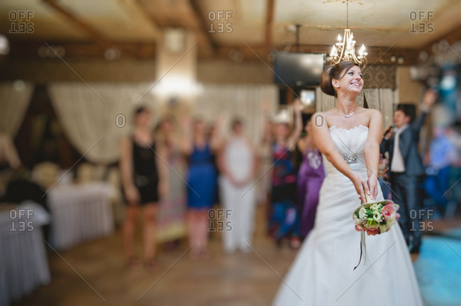 Bride throwing the bridal bouquet