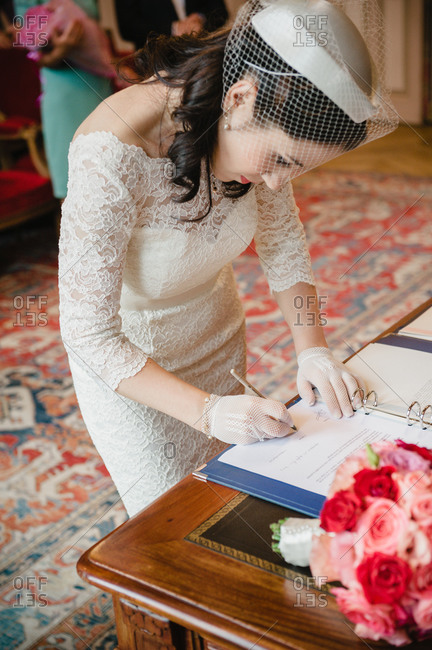 Bride signing the register at a civil wedding ceremony