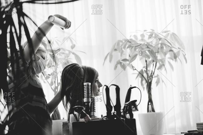 Applying hair spray on bride's hair