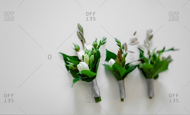 Close up of three boutonnieres