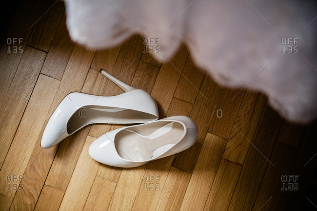 White wedding shoes on the floor