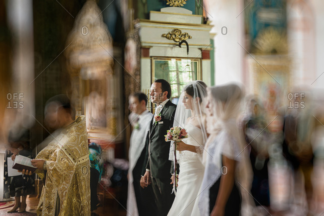 Bride and groom at an Orthodox wedding ceremony