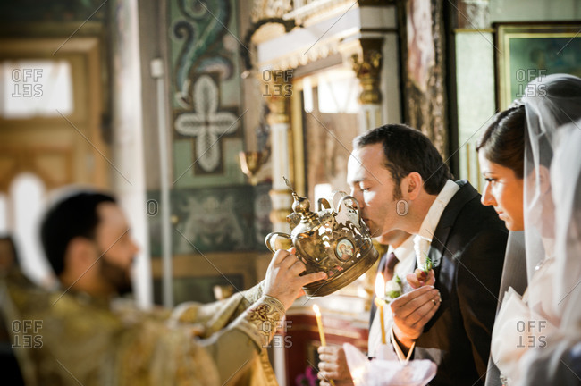 Groom kissing a crown at an Orthodox wedding