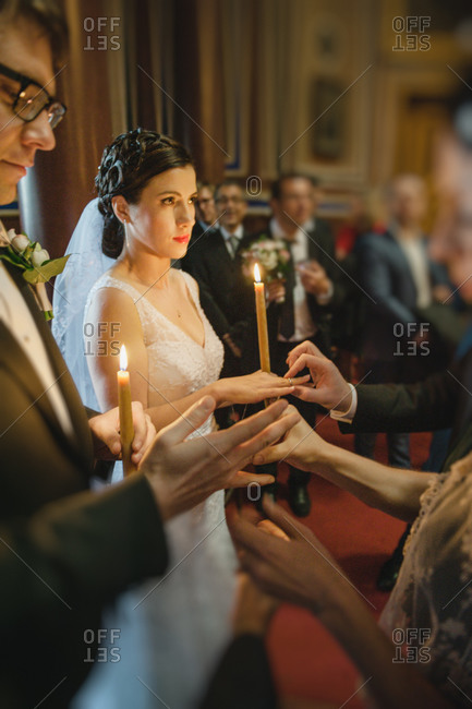 Rings being placed on the couple's fingers during Orthodox ceremony