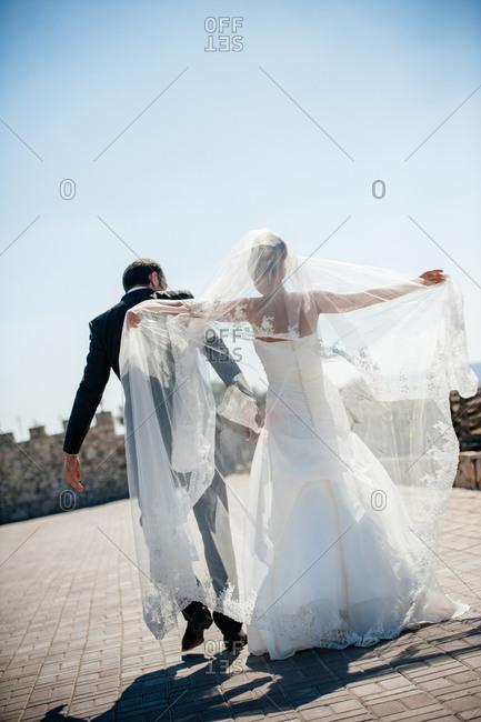 Newlyweds dancing outside