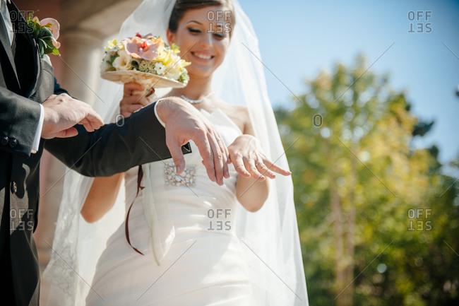 Newlyweds showing their wedding rings